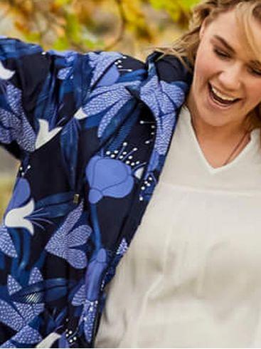 ALE Γυναικεία λευκή κοντομάνικη ασύμμετρη μακριά μπλούζα